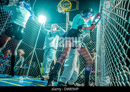 Sitges, Spain. March 2nd, 2014: Revellers dance in a cage during the Sunday parade of the carnival in Sitges Credit: - Stock Photo