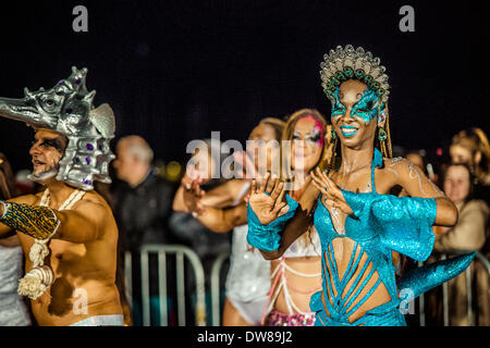 Sitges, Spain. March 2nd, 2014: Camilla, Queen of carnival Sitges 2013, dances during the Sunday carnival parade - Stock Photo