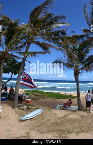 Family gathering on Sandy Beach, East Oahu, Hawaii, USA - Stock Photo