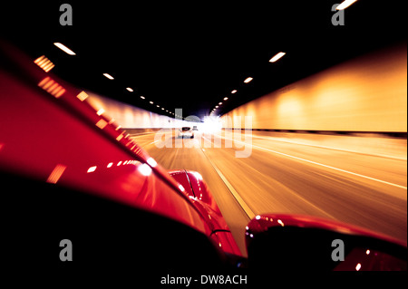 Sport car chasing in the tunnel - Stock Photo