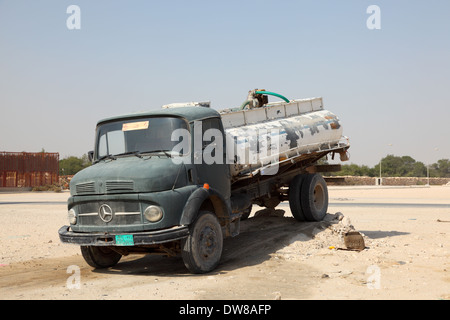 Old Mercedes Benz water truck in Qatar, Middle East - Stock Photo