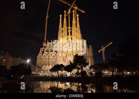 Basilica of La Sagrada Familia at night in Barcelona. - Stock Photo