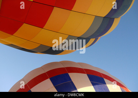 Two hot air balloons, as they are launched in Albuquerque New Mexico - Stock Photo
