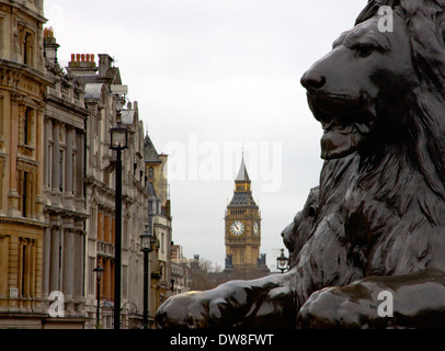 London's Trafalgar square Lions two statues with Big Ben Westminster clock tower in background - Stock Photo