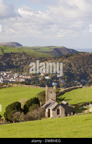 View of church village woodland and coastline on sunny morning Church of St. John Countisbury Countisbury Hill above - Stock Photo
