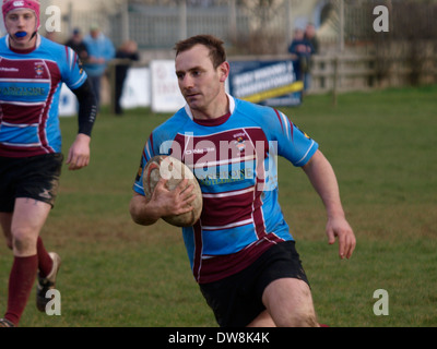 Amateur rugby player carrying the ball, Bude, Cornwall, UK - Stock Photo