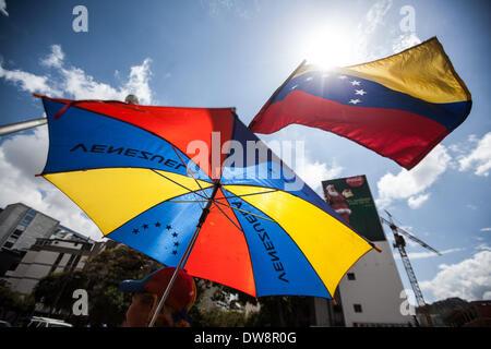 Caracas, Venezuela. 3rd Mar, 2014. A woman holds a national flag of Venezuela during a anti-government protest in Caracas, Venezuela, on March 3, 2014. Credit:  Boris Vergara/Xinhua/Alamy Live News Stock Photo