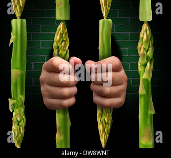 Restricted diet and calorie restriction food concept with prison bars made of asparagus vegetables and hands of - Stock Photo