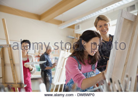 Woman taking adult painting lessons - Stock Photo