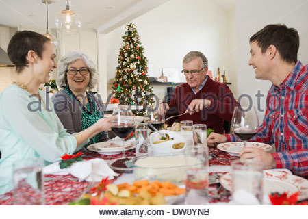 Family enjoying Christmas meal together - Stock Photo