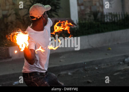 Caracas, Venezuela. 3rd Mar, 2014. A demonstrator throws fire projectiles in a clash against the Bolivarian National Police during a protest in Altamira, east Caracas, Venezuela, on March 3, 2014. Credit:  Boris Vergara/Xinhua/Alamy Live News Stock Photo