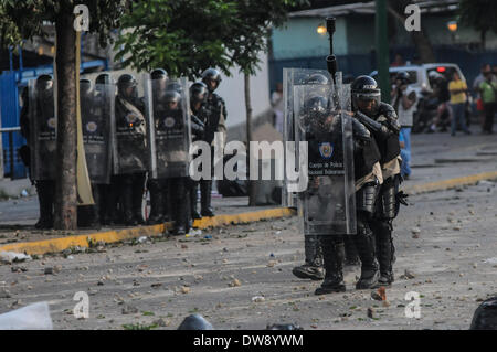 Caracas, Venezuela. 3rd Mar, 2014. Members of the Bolivarian National Police cover themselves in a clash against demonstrators, during a protest in Altamira, east Caracas, Venezuela, on March 3, 2014. Credit:  Manaure Quintero/Xinhua/Alamy Live News Stock Photo