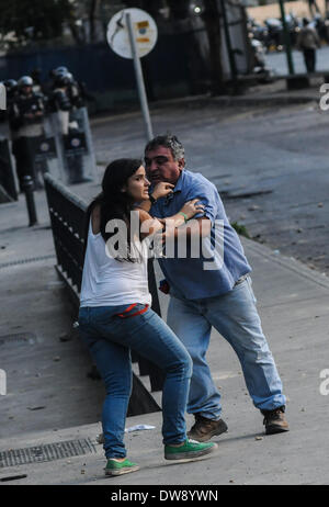 Caracas, Venezuela. 3rd Mar, 2014. Demonstrators react in a clash against the Bolivarian National Police, during a protest in Altamira, east Caracas, Venezuela, on March 3, 2014. Credit:  Manaure Quintero/Xinhua/Alamy Live News Stock Photo