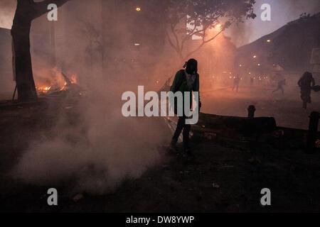 Caracas, Venezuela. 3rd Mar, 2014. A demonstrator participates in a clash against the Bolivarian National Police during a protest in Altamira, east Caracas, Venezuela, on March 3, 2014. Credit:  Boris Vergara/Xinhua/Alamy Live News Stock Photo
