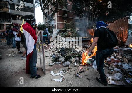 Caracas, Venezuela. 3rd Mar, 2014. Demonstrators participate in a clash against the Bolivarian National Police during a protest in Altamira, east Caracas, Venezuela, on March 3, 2014. Credit:  Boris Vergara/Xinhua/Alamy Live News Stock Photo
