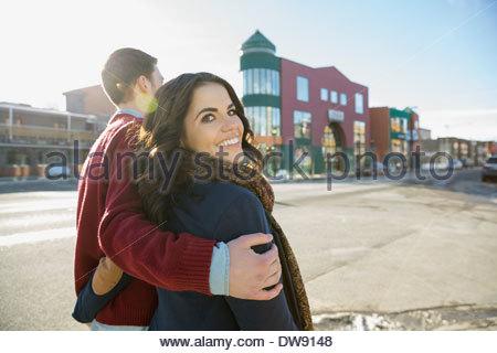 Couple walking down city street - Stock Photo