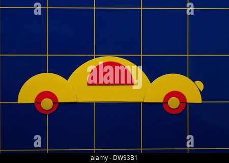 Yellow art illustration of car on blue background. Toy for children. - Stock Photo