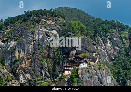 Rock face with the Taktsang Palphug Monastery or Tiger's Nest, Taktshang, Bhutan - Stock Photo