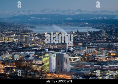Cityscape, Lake Zurich at the rear, Swiss Alps on the horizon, Zurich, Switzerland - Stock Photo