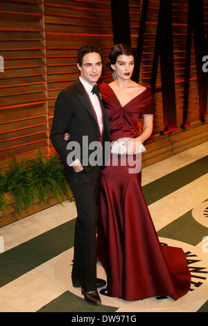 West Hollywood, Los Angeles, USA. 02nd Mar, 2014. Fashion designer Zac Posen and US model Crystal Renn arrive at - Stock Photo