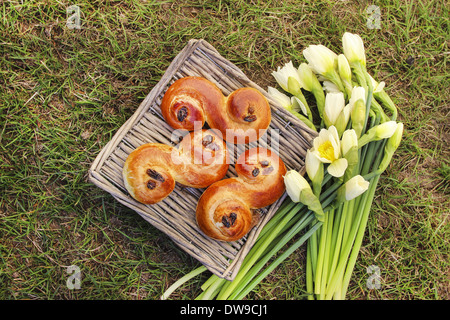 Traditional swedish buns in wicker basket.Traditional swedish buns in wicker basket. - Stock Photo
