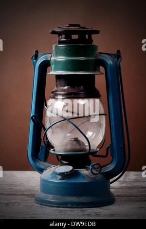 old rusty kerosene lamp - Stock Photo