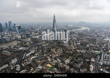 Aerial Photograph showing The Shard with the City of London visible and Canary Wharf in the background - Stock Photo