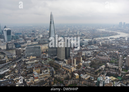 Aerial Photograph showing The Shard with the City of London and Canary Wharf in the background - Stock Photo