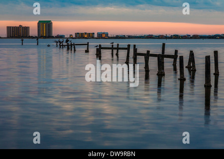 Dilapidated pier extends into the Santa Rosa Sound at Navarre, Florida - Stock Photo