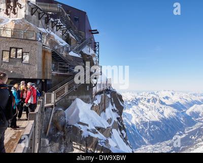 People on bridge viewing platform at Aiguille du Midi top téléphérique cable-car station. Chamonix-Mont-Blanc Rhone - Stock Photo