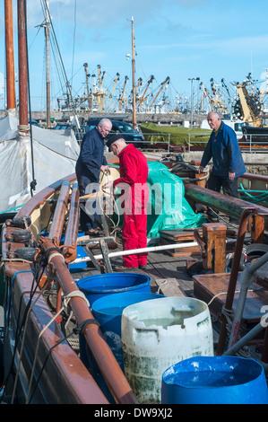 sailors repairing old boat in brixham,devon,fishing fleet docked at Brixham Harbour,Architecture,Brixham,Building - Stock Photo