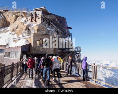 People on bridge viewing platform at Aiguille du Midi top téléphérique cable car station. Chamonix-Mont-Blanc Rhone - Stock Photo