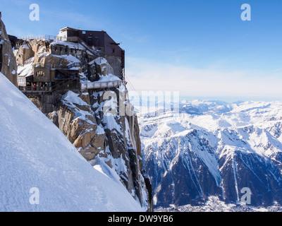 Aiguille du Midi top téléphérique cable-car station in winter snow in French Alps above Chamonix-Mont-Blanc, Haute - Stock Photo