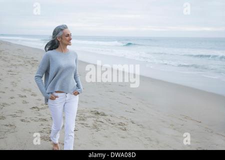 Mature woman walking on beach, Los Angeles, California, USA - Stock Photo