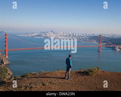 Young male tourist looking at Golden gate bridge, San Francisco, California, USA - Stock Photo