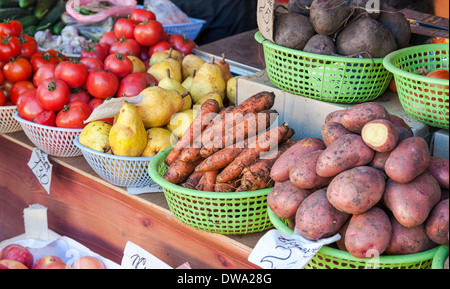 Raw vegetables and fruits ready for sale in local market - Stock Photo