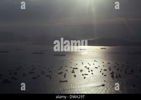 Aerial view of harbor and South China Sea shipping, Hong Kong, China - Stock Photo