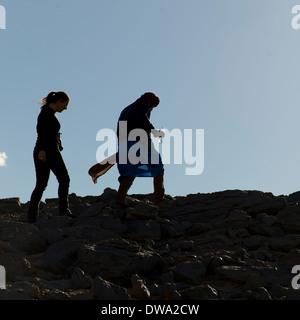 People walking in the Sahara Desert, Guelmim-Es Semara, Erg Chegaga Dunes, Sahara Desert, Morocco - Stock Photo