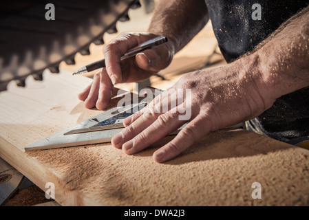 Close up of male carpenter with set square in workshop - Stock Photo