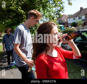 Friends drinking beer in street - Stock Photo