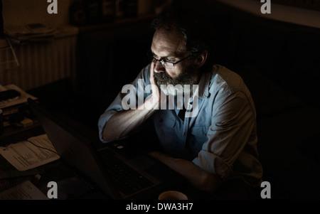 Mature man working late