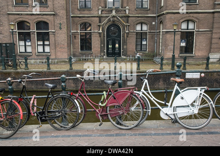 Bikes parked along the canal, Amsterdam Netherlands - Stock Photo
