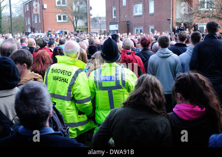 Ashbourne, Derbyshire, UK. 4th March 2014.The historic game of of shrovetide football took place today under clear - Stock Photo