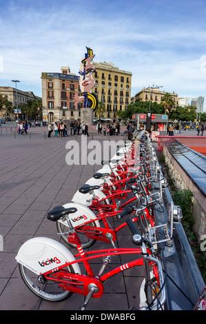 Rental bikes , background Sculpture El Cap de Barcelona by Roy Liechtenstein, Barcelona - Stock Photo