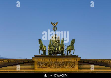Quadiga on top of Brandenburg gate in Berlin - Stock Photo