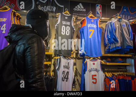 3db6c3b0c4c Brooklyn Nets basketball store in Coney Island · Jason Collins' number 98  Brooklyn Nets basketball jersey is seen amongst other players' uniforms