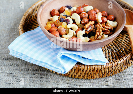 combination of various nuts in a large bowl, food closeup - Stock Photo