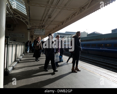 Rail passengers waiting for train on the platform at Cardiff Central Railway Station (Cardiff Train Station) in - Stock Photo