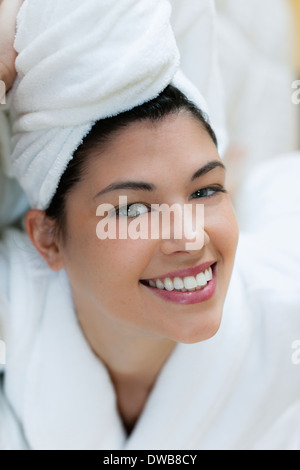 Young woman in bathrobe and turban - Stock Photo