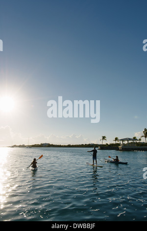 Kayakers and paddle boarder, Providenciales, Turks and Caicos Islands, Caribbean - Stock Photo